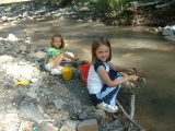 Kids playing by creek