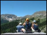 Guests watching mountain goats on the Tushar Mountains from the Paiute Trail